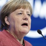 Merkel given standing ovation after rare, stinging Trump takedown