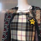 An image of a Miu Miu dress that was pulled from sale after complaints it resembled a yellow star worn by Jews in Nazi Germany.
