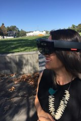 Mikaela Jade using VR goggles.