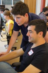 Lachy teaching a student some programming.