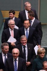 Prime Minister Tony Abbott with his ministers after a condolence motion for former prime minister Gough Whitlam on Tuesday.