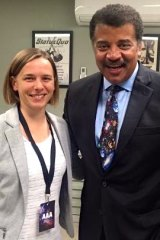 Harvey-Smith with renowned American astrophysicist Neil deGrasse Tyson in 2015.