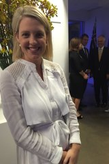 Georgina Dent wearing the dress she purchased through Instagram to an official function attended by the Prime Minister.