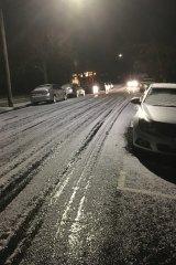 Snow on Victoria Street, Macedon on Thursday evening.