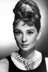 Audrey Hepburn poses as Holly Golightly in Breakfast at Tiffany's.