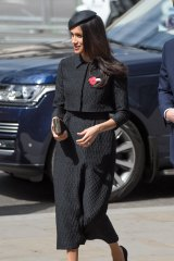 Meghan Markle, wearing a black Emilia Wickstead jacket and skirt and a Philip Treacy hat, attends the Anzac Day service at Westminster Abbey in London on April 25.