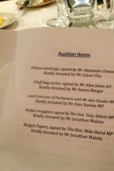 For sale ... the auction items sold at the Young Liberals dinner, including the chaff-bag jacket, signed by Alan Jones.