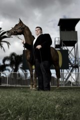 Mining magnate... Tinkler poses at Randwick Racecourse with one of his mares.