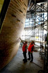 Father and son: Peter and Ray Favetti with part of the completed angled wall.