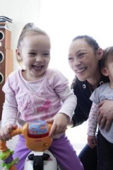 'I want to train myself up to get a good job. I can't rely on the government to... look after my kids.' Sharlie Liew, with daughters Sharmia, 2, and Laura-Joan, 1.