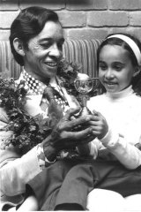Frank Reys and Shelley Reys hold the 1973 Melbourne Cup.