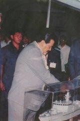 Former Philippines president Joseph Estrada (left) greets Tenix executives.