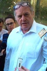 Queensland Housing Minister Bruce Flegg's former senior media officer Graeme Hallett.
