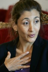 Learning to adapt: Ingrid Betancourt answers questions during a news  conference at a Paris hotel.