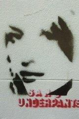 Stencil graffiti by Banksy in Melbourne.