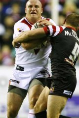 Michael Weyman is tackled by Michael McIlorum.