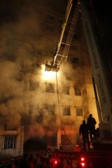 Bangladeshi firefighters trying to extinguish a fire at the nine-storey Tazreen Fashion plant in Savar, north of Dhaka.