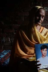 The ultimate cost: Drug widow Darshan with a photo of her dead son Raju.