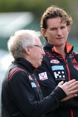 Coach James Hird with club doctor Bruce Reid.