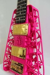 A close-up of a 3D-printed guitar.