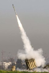 Missile defence in action - an Israeli missile is launched from the Iron Dome missile system.