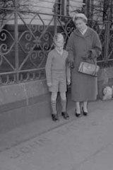 Robert Waddell, aged nine, with his mother Beryl at the corner of Flinders and Williams streets in 1960.