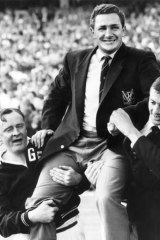 As coach, Bob Davis is chaired off the MCG after Geelong defeated Hawthorn in the 1963 Grand Final.