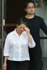 2005: Kim Nguyen leaving Singapore's Changi prison, with her son Khoa, after visiting her other son Nguyen Van Tuong, who was then still alive.