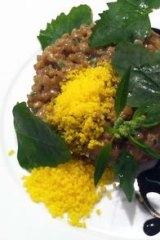 Cracked-soba risotto: house-cured Knoll Krest egg yolk, nasturtium leaf.