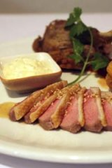 Duck three ways - duck spring roll, rare caramelised breast and crispy Sichuan peppered leg.