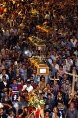 A mass funeral makes its way to the Abbasiya Cathedral.