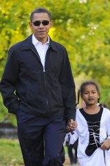 Senator Barack Obama and his daughter Sasha, 7, dressed up for Halloween.