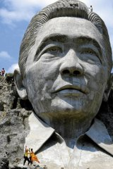 Rock and rolled … a Mount Rushmore-like sculpture of Ferdinand Marcos at Marcos Park in Pugo, before it was destroyed in 2002 by persons unknown.