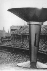 Ron Clarke lighting the Olympic flame, Melbourne 1956.