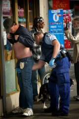 Police stop search some men in Victoria street, Richmond where a proposed safe injecting room is being proposed.