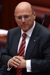 """""""Watch this space. I will be vindicated"""": Assistant Treasurer Senator Arthur Sinodinos during Senate question time on Tuesday."""