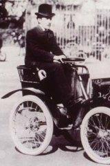 Entrepreneur ... Renault drives a miniature car in 1899.
