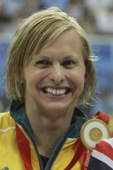 Libby Trickett with her gold medal  after winning the women's 100m butterfly final at the 2008 Beijing Olympics.