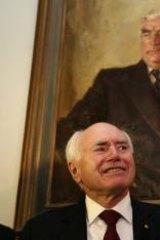 Conservative bent: Former Prime Minister John Howard with Prime Minister Tony Abbott.