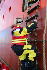 Fairfax Media's Nicky Phillips climbs aboard the Aurora Australis.