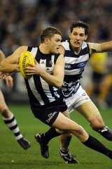 Geelong's Harry Taylor in pursuit of Collingwood's Heath Shaw during their round 19 cclash.