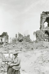 A portrait of  Evelyn Chapman, the first Australian female artist to visit the battlefields, while at work in Villers-Bretonneux 1919.This photograph shows all that is left of the church of Villers-Bretonneux.