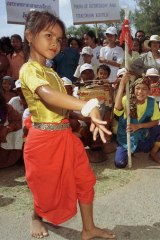 A young Cambodian girl performs the jeeb hand position during a traditional dance.