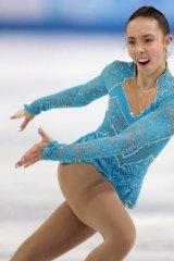 Joyful ... Brooklee Han of Australia competes in the women's short program figure skating competition.