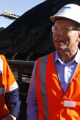 Carbon tax fight ... Tony Abbott tours a Hunter Valley coalmine yesterday.