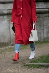 A guest wears the Celine mismatched shoes at the Chanel show during Paris Fashion Week in March.