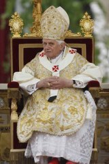 Pope Benedict XVI looks on as he leads the Easter mass in Saint Peter's Square.