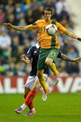 Kruse control … Robbie Kruse battles Scotland's Alan Hutton on Wednesday.
