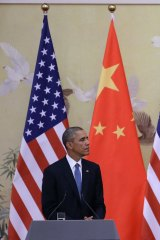 US President Barack Obama (left) and Chinese President Xi Jinping attend a press conference at the Great Hall of People in Beijing in 2014. Photo: Getty Images