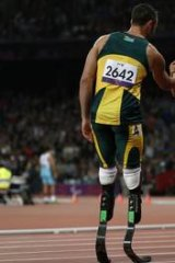 """Not a fair race"" ... Alan Oliveira (R) is congratulated by South Africa's Oscar Pistorius."